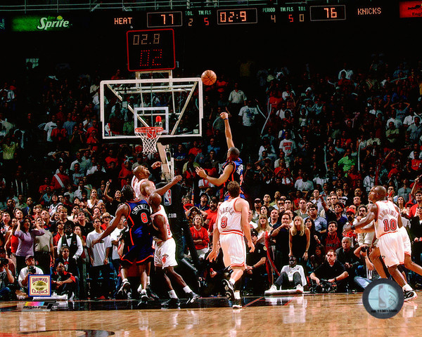 Heat fans hold their breath as Allan Houston hoists up the floater. (AP)