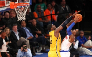 May 5, 2013; New York, NY, USA; New York Knicks guard J.R. Smith (8) takes a shot against Indiana Pacers center Roy Hibbert (55) during the second quarter at Madison Square Garden. Mandatory Credit: Danny Wild-USA TODAY Sports