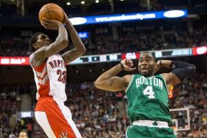 Toronto Raptors' Lou Williams, left, shoot on Boston Celtics' Marcus Thornton during second half NBA pre-season basketball action in Toronto on Friday, October 10, 2014. THE CANADIAN PRESS/Chris Young