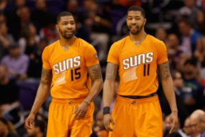 PHOENIX, AZ - JANUARY 30:  (L-R) Marcus Morris #15 and Markieff Morris #11 of the Phoenix Suns check in during the second half of the NBA game against the Chicago Bulls at US Airways Center on January 30, 2015 in Phoenix, Arizona. The Suns defeated the Bulls 99-93. NOTE TO USER: User expressly acknowledges and agrees that, by downloading and or using this photograph, User is consenting to the terms and conditions of the Getty Images License Agreement.  (Photo by Christian Petersen/Getty Images)