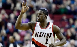 Portland Trail Blazers guard Wesley Matthews holds up three fingers after sinking a three point basket during the second half of an NBA basketball game against the Utah Jazz in Portland, Ore., Friday, Dec. 6, 2013.  Wesley topped the Trail Blazers in scoring with 24 points, including four three point shots,  as they beat Utah 130-98. (AP Photo/Don Ryan)
