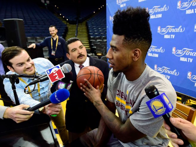 Jun 3, 2015; Oakland, CA, USA; Cleveland Cavaliers guard Iman Shumpert (4) talks to the media with Television personalty Guillermo Rodriguez behind him during practice prior to the NBA Finals at Oracle Arena. Mandatory Credit: Bob Donnan-USA TODAY Sports ORG XMIT: USATSI-225922 ORIG FILE ID: 20150603_pjc_sd2_056.JPG
