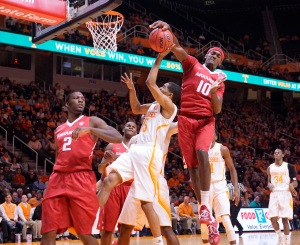 Arkansas' Bobby Portis (10) Rejects the shot of Tennessee's Detrick Mostella (15) as Arkansas' Alandise Harris (2) looks on in the first half of an NCAA college basketball game Tuesday, Jan. 13, 2015, in Knoxville, Tenn. (AP Photo/Patrick Murphy-Racey)