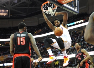 KRISTIN BAUER   CHRONICLE                          The Cav's Tristan Thompson (13) dunks to ball during a game against Toronto at the Quicken Loans Arena on Tuesday, March 25.