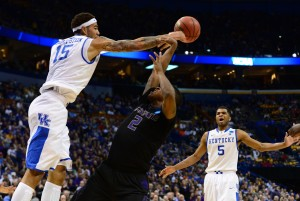 Mar 21, 2014; St. Louis, MO, USA; Kentucky Wildcats forward Willie Cauley-Stein (15) blocks a shot ky Kansas State Wildcats guard Marcus Foster (2) in the first half during the 2nd round of the 2014 NCAA Men's Basketball Championship at Scottrade Center. Mandatory Credit: Jasen Vinlove-USA TODAY Sports