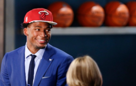 Justise Winslow waits to be interviewed after being selected 10th overall by the Miami Heat during the NBA basketball draft, Thursday, June 25, 2015, in New York. (AP Photo/Kathy Willens)