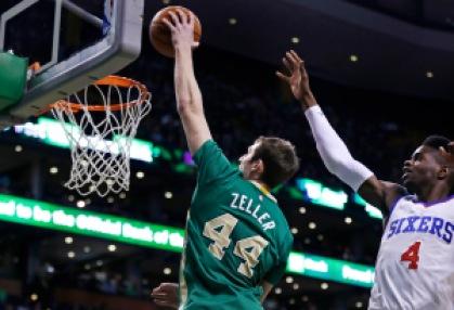 Boston Celtics center Tyler Zeller (44) drives past Philadelphia 76ers center Nerlens Noel (4) for a dunk during the first quarter of an NBA basketball game in Boston, Monday, March 16, 2015. (AP Photo/Charles Krupa)