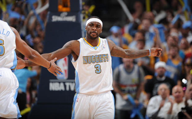 DENVER, CO - MAY 10: Ty Lawson #3 of the Denver Nuggets celebrates while playing against the Los Angeles Lakers in Game Six of the Western Conference Quarterfinals during the 2012 NBA Playoffs on May 10, 2012 at the Pepsi Center in Denver, Colorado. NOTE TO USER: User expressly acknowledges and agrees that, by downloading and/or using this Photograph, user is consenting to the terms and conditions of the Getty Images License Agreement. Mandatory Copyright Notice: Copyright 2012 NBAE (Photo by Garrett W. Ellwood/NBAE via Getty Images)